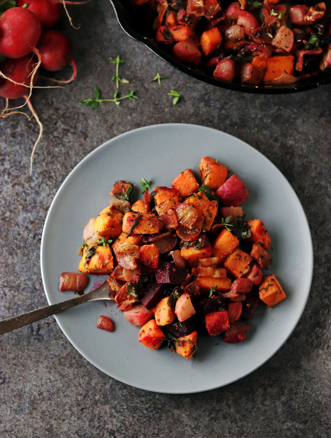 This Red Flannel Hash is healthy and delicious, making it a perfect meal option for individuals that follow an AIP, Paleo or Whole 30 lifestyle. It incorporates a variety of colorful vegetables including beets, sweet potatoes, radishes, onions, and beet leaves.